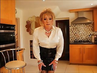 Sindy in satin blouse and pvc skirt