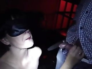 Masked amateur MILF bukkake blowbang in cinema