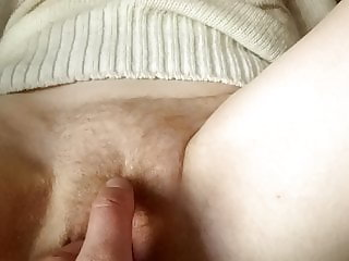Trying to stick his hand in her pussy