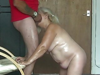 68 yo Fat greasy granny on her knees gagging on my cock