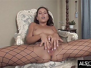 Sexy babe in fishnet pantyhose fingers herself to climax
