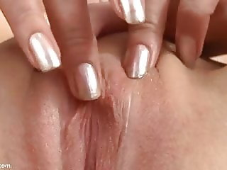 Abigail fingers her clit until she climaxes.