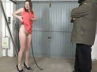 woman chained in Garage pissing