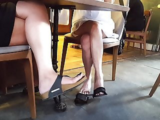 Girls sexy legs feets upskirts under table