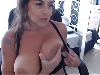 Playful mother with big natural tits gets orgasm