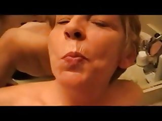 Grandma sucking young dick in the bathroom