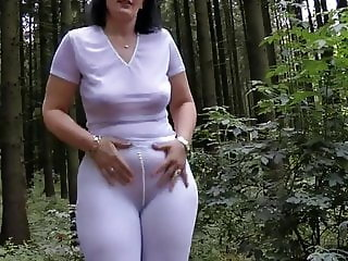 mature walking in forrest