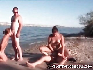 Velvet Swingers Club couples fucking on the beach
