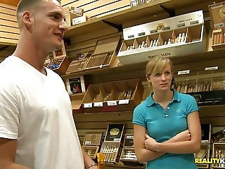 Sexy Blonde nude for cash at the Cigar Shop