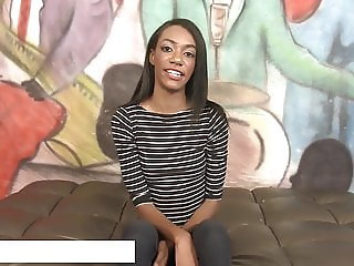 Ebony hottie gags on cock