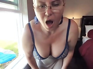 busty mature masturbating in the window