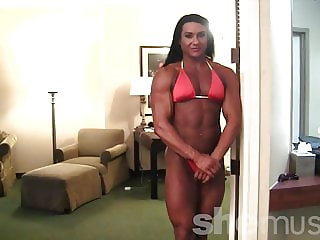 Mature huge female bodybuilder with a mega ass poses