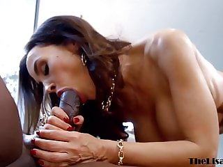 Busty MILF Lisa Ann riding hard before interracial facial