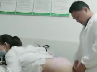 Chinese doctor and nurse doggy in hospital office