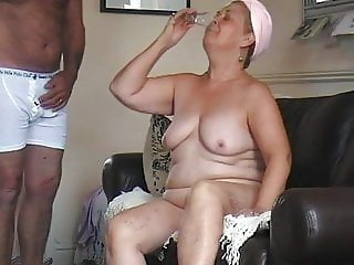 Repoting grammy drinks cum from a shot glass