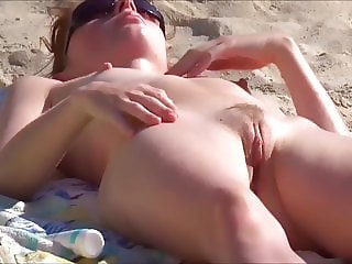 Girls with shaved pussy on the beach