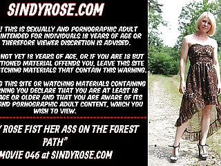 Sindy Rose fist her ass on the forest path