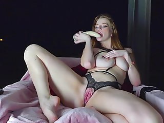 Redhead babe plays with dildo