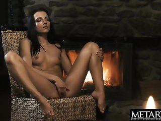 'Stunning nude model Sapphira fingers her juicy pussy by the fire'
