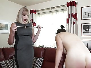 A mistress, a sexy maid and a stinging cane
