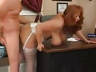 Redhead busty secretary fucked in the office