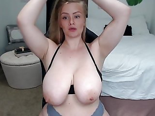 Thicc blonde reveals big tits and ass and licks nipples 2