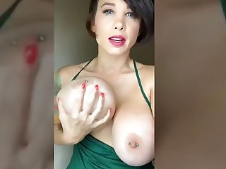 EXTREME, sexy cougar MILF presents huge tits with pierced nipples